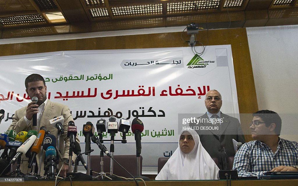 Osama (L), Shaimaa (C) and Abdulah (R) Mohamed Morsi, the sons and daughter of Egypt's ousted president Mohamed Morsi give a press conference in Cairo on July 22, 2013. The family of Morsi is to take legal action against Egypt's army chief, General Abdel Fattah al-Sisi, for 'kidnapping' the Islamist president, Shaimaa said.