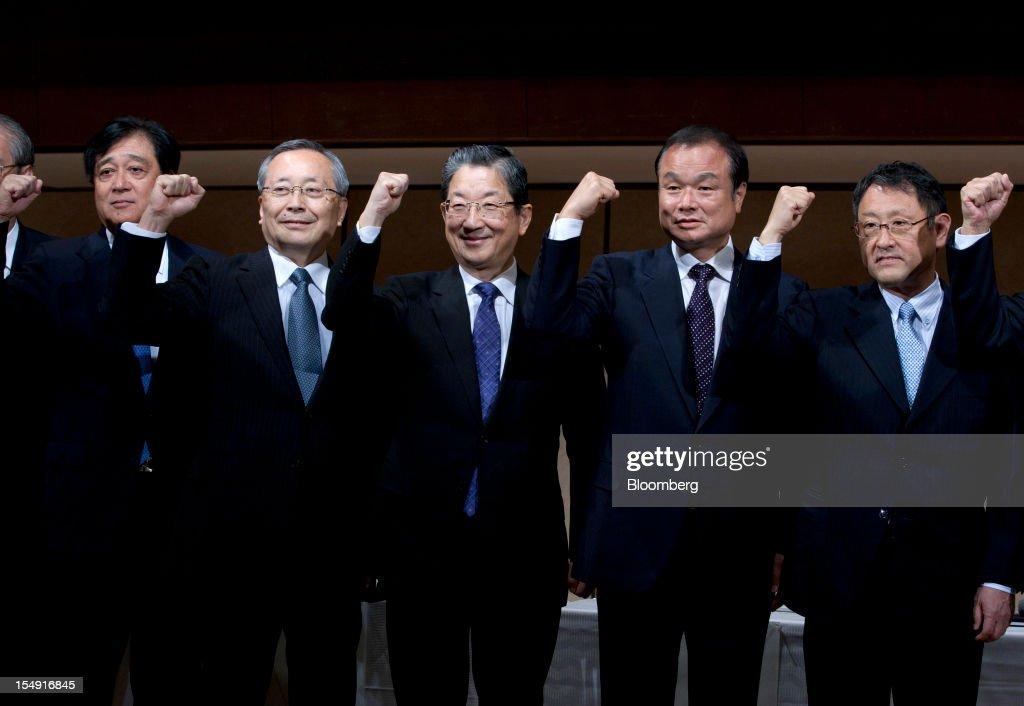 Osamu Masuko president of Mitsubishi Motors Corp from left Takashi Yamanouchi chief executive officer of Mazda Motor Corp Toshiyuki Shiga chief...