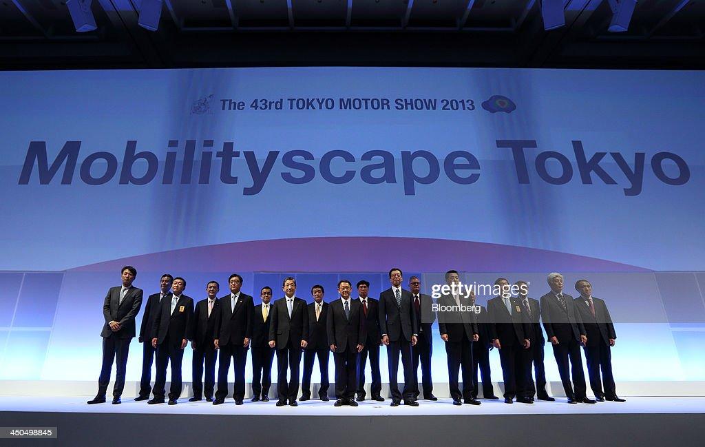 Osamu Masuko president of Mitsubishi Motors Corp from third left to right in the front row Toshiyuki Shiga vice chairman of Nissan Motor Co Akio...