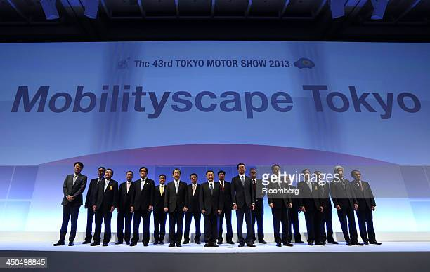 Osamu Masuko president of Mitsubishi Motors Corp from third left to right in the front row Toshiyuki Shiga vice chairman of Nissan Motor Co Akio...