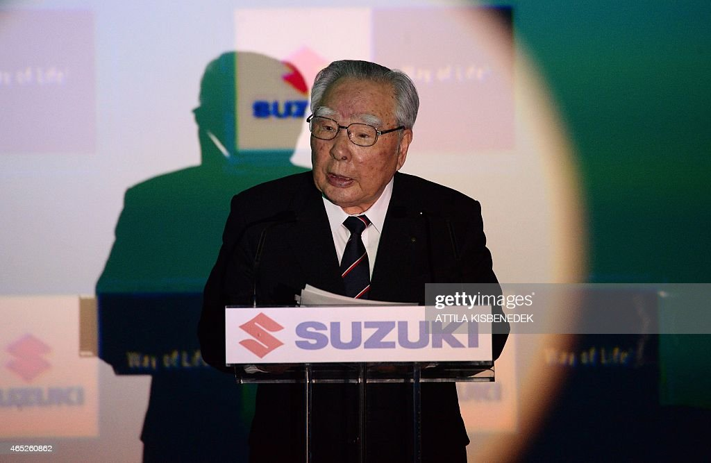 <a gi-track='captionPersonalityLinkClicked' href=/galleries/search?phrase=Osamu+Suzuki&family=editorial&specificpeople=580987 ng-click='$event.stopPropagation()'>Osamu Suzuki</a> , CEO of Japan's automaker Suzuki Motor Corporation, delivers a speech on March 5, 2015 at the Suzuki's factory of Esztergom, Hungary, during a presentation of the new product car model Vitara. KISBENEDEK