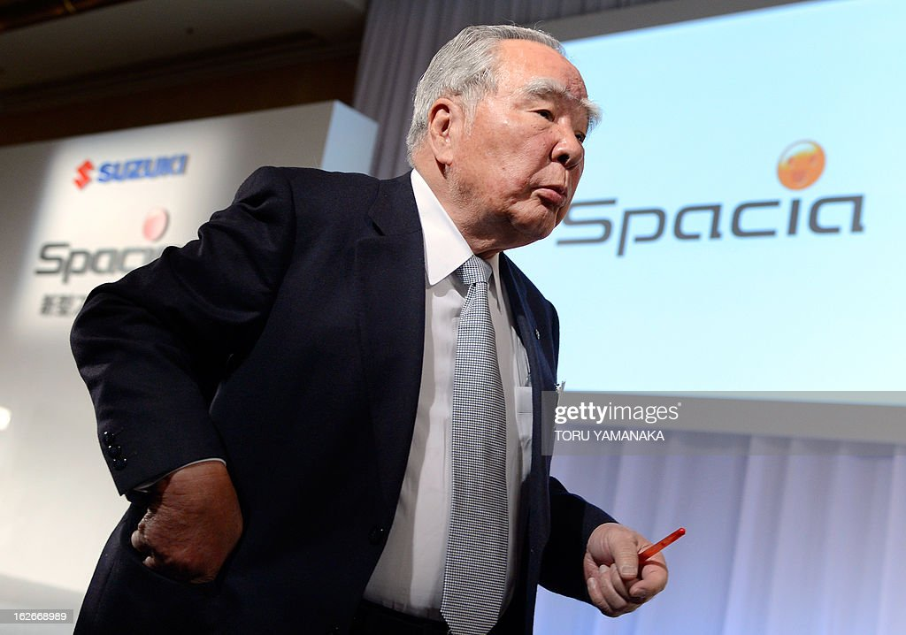 Osamu Suzuki, chairman and president of Japan's auto maker Suzuki Motor, heads for a photo session during a press conference to introduce its new mini car 'Spacia' in Tokyo on February 26, 2013. Suzuki will put the new 660cc gasoline engine, wagon-type vehicle that averages 29km per litre of fuel, on the domestic market from March 15. AFP PHOTO/Toru YAMANAKA