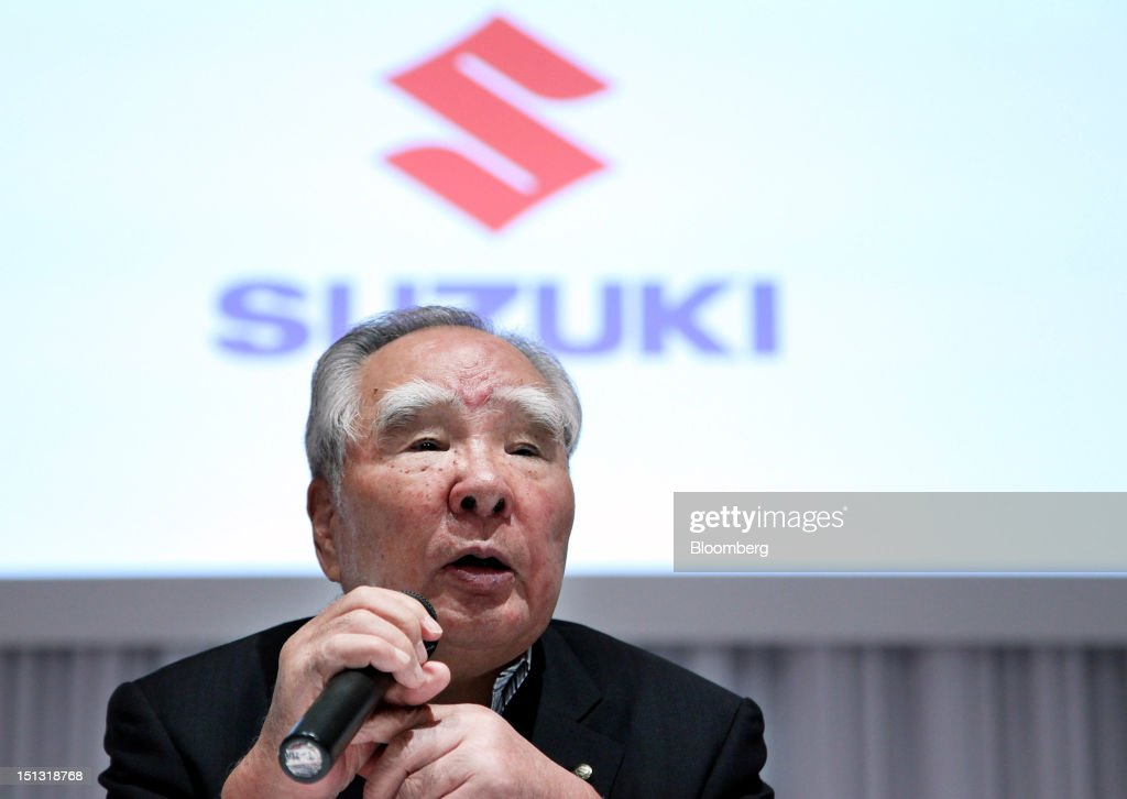 <a gi-track='captionPersonalityLinkClicked' href=/galleries/search?phrase=Osamu+Suzuki&family=editorial&specificpeople=580987 ng-click='$event.stopPropagation()'>Osamu Suzuki</a>, chairman and president of Suzuki Motor Corp., speaks during an unveiling of the company's Wagon R minicar in Tokyo, Japan, on Thursday, Sept. 6, 2012. Suzuki Motor Corp. said it expects production at the Manesar, India, factory run by its local unit to recover to 800 cars a day this month after riots over a labor dispute in July caused its closure for a month. Photographer: Haruyoshi Yamaguchi/Bloomberg via Getty Images