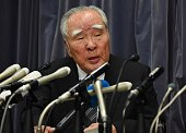 Osamu Suzuki chairman of Japan's automaker Suzuki answers questions during a press conference after reporting to the transport ministry in Tokyo on...