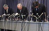 Osamu Suzuki chairman of Japan's automaker Suzuki bows with company vice president Osamu Honda and president Toshihiro Suzuki during a press...