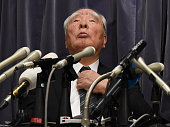 Osamu Suzuki chairman of Japan's automaker Suzuki listens to questions during a press conference after reporting to the transport ministry in Tokyo...