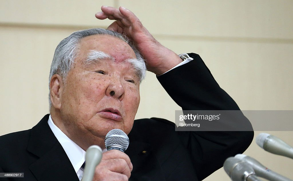 <a gi-track='captionPersonalityLinkClicked' href=/galleries/search?phrase=Osamu+Suzuki&family=editorial&specificpeople=580987 ng-click='$event.stopPropagation()'>Osamu Suzuki</a>, chairman, president and chief executive officer of Suzuki Motor Corp., scratches his head as he speaks during a news conference in Tokyo, Japan, on Friday, May 9, 2014. Vehicle deliveries last month in Japan fell to the lowest since December 2012 after Japan raised its consumption tax for the first time in 17 years, according to industry figures released on May 2. Photographer: Tomohiro Ohsumi/Bloomberg via Getty Images