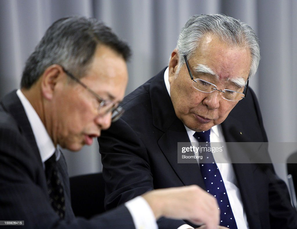 Osamu Suzuki, president and chairman of Suzuki Motor Corp., right, speaks with Toyokazu Sugimoto, director and senior managing officer, at a news conference in Tokyo, Japan, on Friday, Nov. 9, 2012. Suzuki Motor's China October sales dropped 29% from a year earlier to 17,000 units. Photographer: Haruyoshi Yamaguchi/Bloomberg via Getty Images Osamu Suzuki; Toyokazu Sugimoto