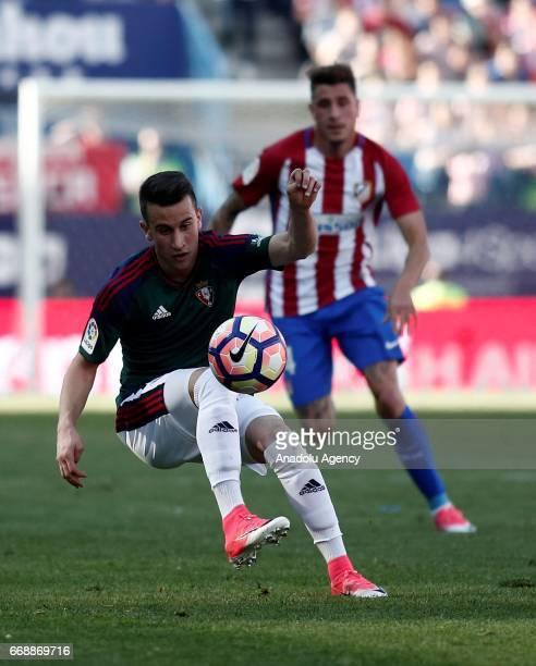 Osasuna's Alex Berenguer is in action during the Spanish soccer league La Liga football match Atletico de Madrid vs CA Osasuna at the Vicente...