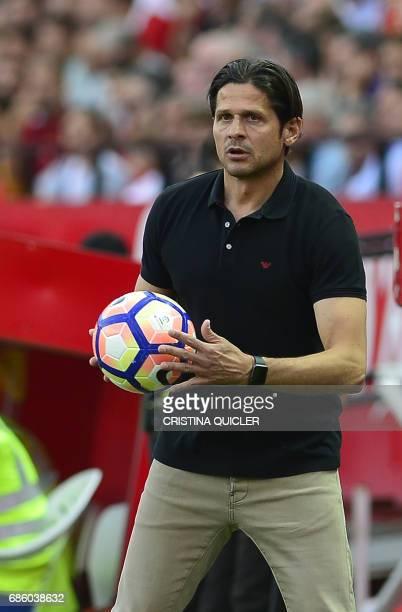 Osasuna's coach Petar Vasiljevic holds the ball during the Spanish league football match Sevilla FC vs CA Osasuna at the Ramon Sanchez Pizjuan...