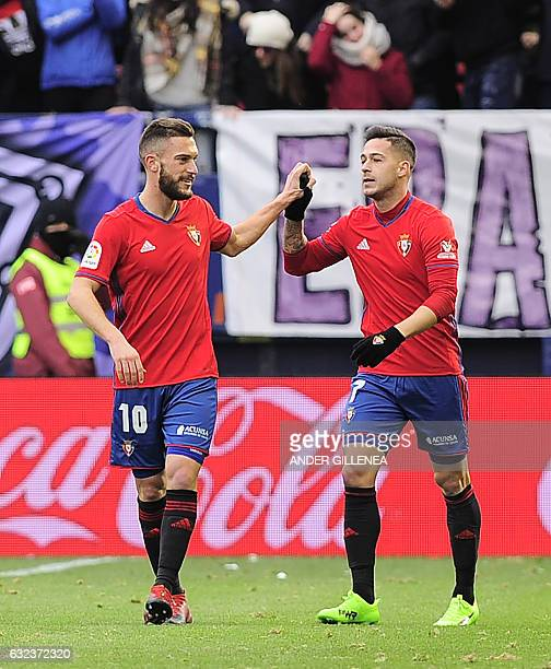 Osasuna's forward Sergio Leon is congratulated by teammate midfielder Roberto Torres after scoring his team's first goal during the Spanish league...