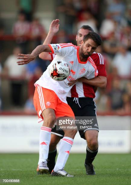 Osasuna's Kenan Kodro holds off the challenge of Brentford's Kevin O'Connor