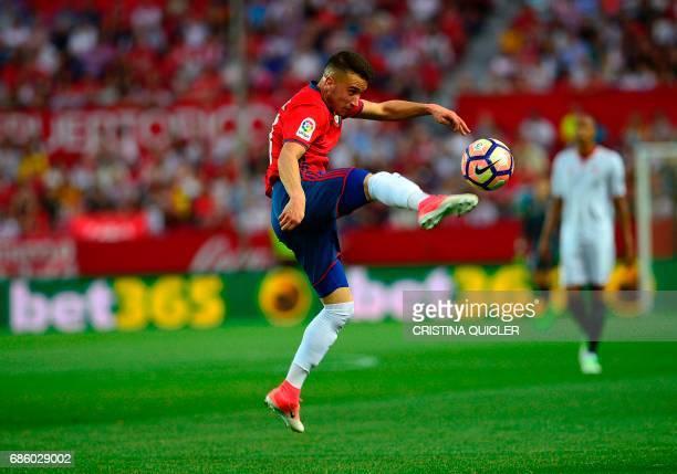 Osasuna's midfielder Alex Berenguer controls the ball during the Spanish league football match Sevilla FC vs CA Osasuna at the Ramon Sanchez Pizjuan...