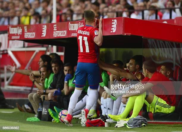 Osasuna's midfielder Alex Berenguer grabs the Osasuna players benchduring the Spanish league football match Sevilla FC vs CA Osasuna at the Ramon...