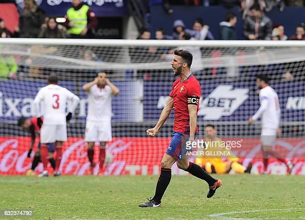 Osasuna's Oier Sanjurjo celebrates after his team's scoring the second goal during the Spanish league football match CA Osasuna vs Sevilla FC at El...