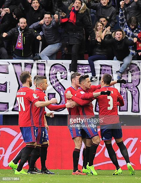 Osasuna's players celebrate after forward Sergio Leon scoring his team's first goal during the Spanish league football match CA Osasuna vs Sevilla FC...