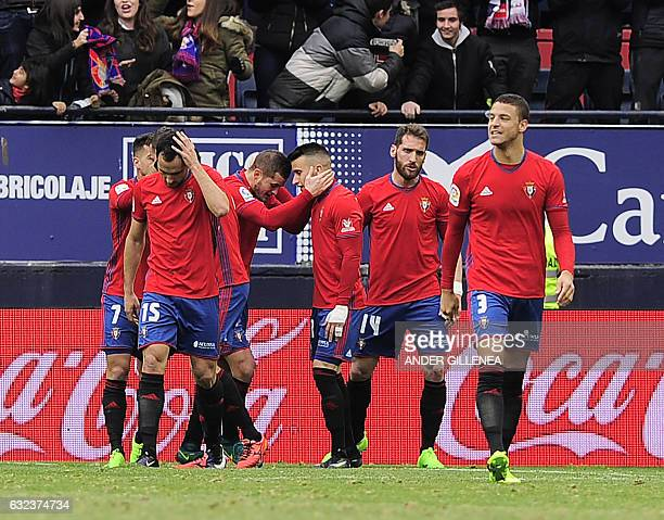 Osasuna's players celebrate after scoring their team's second goal during the Spanish league football match CA Osasuna vs Sevilla FC at El Sadar...