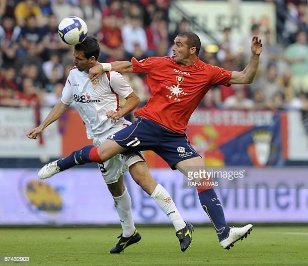 Osasuna's Walter Pandiani vies with Sevilla's Fernando Navarro during a Spanish league football match on May 16 at Reyno de Navarra stadium in...