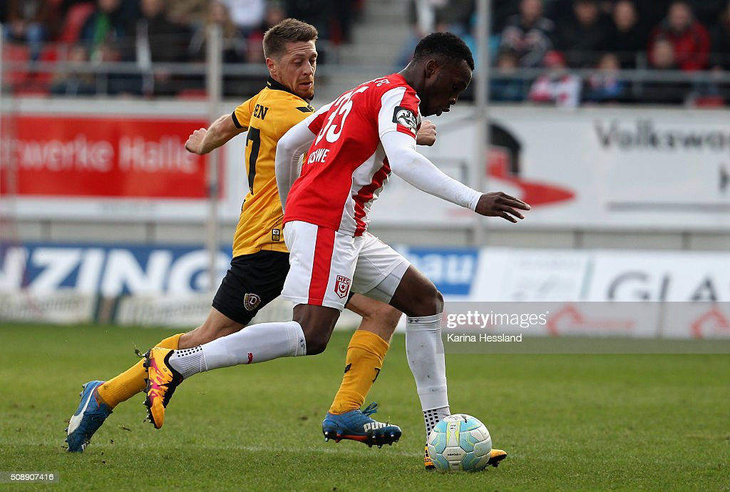 Osayamen Osawe of Halle challenges <a gi-track='captionPersonalityLinkClicked' href=/galleries/search?phrase=Andreas+Lambertz&family=editorial&specificpeople=2505535 ng-click='$event.stopPropagation()'>Andreas Lambertz</a> of Dresden during the Third League match between Hallescher FC and SG Dynamo Dresden at erdgas Sportpark on February 07, 2016 in Halle, Germany.