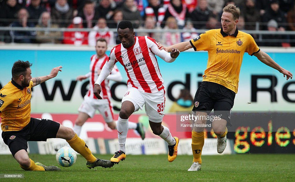 Osayamen Osawe of Halle challenges Giuliano Modica and Marco Hartmann of Dresden during the Third League match between Hallescher FC and SG Dynamo Dresden at erdgas Sportpark on February 07, 2016 in Halle, Germany.