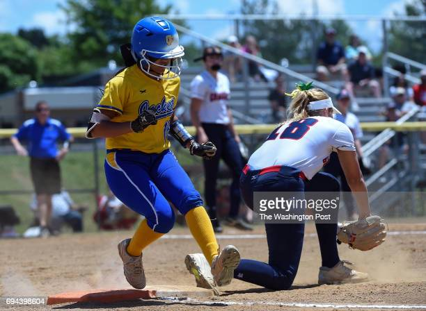 Osborn Park's Yari Santos beats the throw to Grassfield's Grace Jewell during the Virginia 6A State Softball Semifinal game between Osbourn Park and...