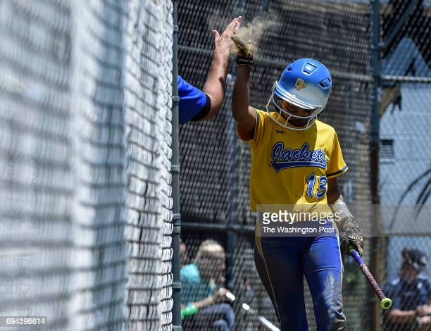 Osborn Park's Yari Santos his hives a coach after scoring during the Virginia 6A State Softball Semifinal game between Osbourn Park and Grassfield at...