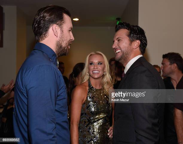 J Osborne of the Brothers Osborne Caroline Boyer and Luke Bryan attend the 2017 CMT Music Awards at the Music City Center on June 7 2017 in Nashville...