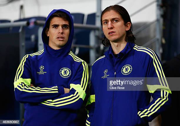 Oscar and Filipe Luis of Chelsea look on prior to the UEFA Champions League Round of 16 match between Paris SaintGermain and Chelsea at Parc des...