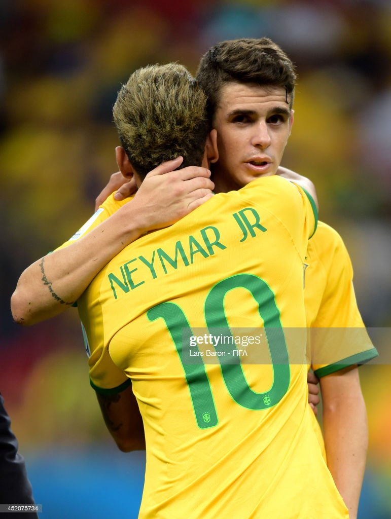 Oscar and Neymar of Brazil react after the 2014 FIFA World Cup Brazil 3rd Place Playoff match between Brazil and Netherlands at Estadio Nacional on July 12, 2014 in Brasilia, Brazil.