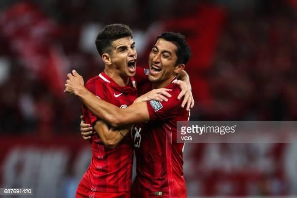 Oscar and Odil Ahmedov of Shanghai SIPG celebrate during 2017 AFC Champions League eighthfinal match between Shanghai SIPG FC and Jiangsu Suning FC...