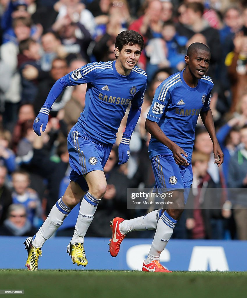 Oscar (L) and Ramires of Chelsea celebrate the equalising goal, an own goal by Matthew Kilgallon of Sunderland during the Barclays Premier League match between Chelsea and Sunderland at Stamford Bridge on April 7, 2013 in London, England.