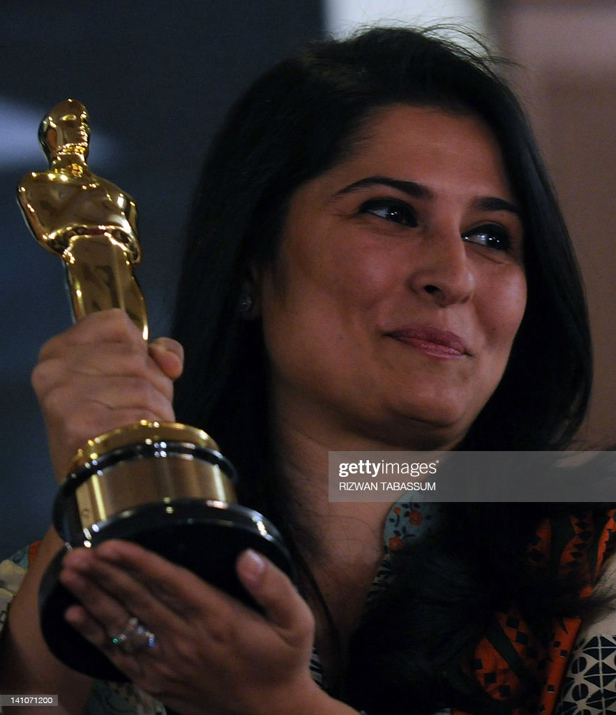 Oscar award winning Pakistani director Sharmeen Obaid-Chinoy shows her Oscar award during a press conference in Karachi on March 10, 2012. Pakistan's first Oscar winner launched a campaign, hoping that her documentary about survivors of acid attacks can help eliminate a crime that disfigures hundreds of women each year. AFP PHOTO/Rizwan TABASSUM
