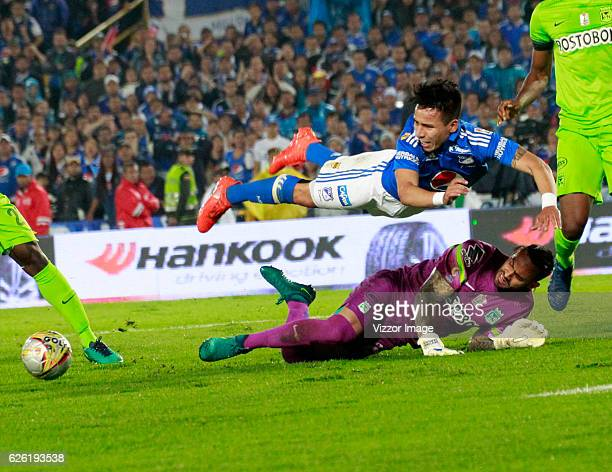 Oscar Barreto of Millonarios fights for the ball with Christian Vargas of Atlético Nacional during a match between Millonarios and Nacional as part...
