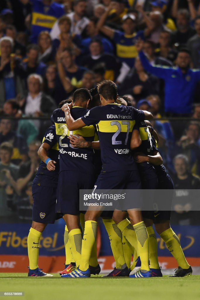 Oscar Benitez of Boca Juniors celebrates with teammates after scoring the first goal of his team during a match between Boca Juniors and Talleres as part of Torneo Primera Division 2016/17 at Alberto J Armando Stadium on March 12, 2017 in Buenos Aires, Argentina.