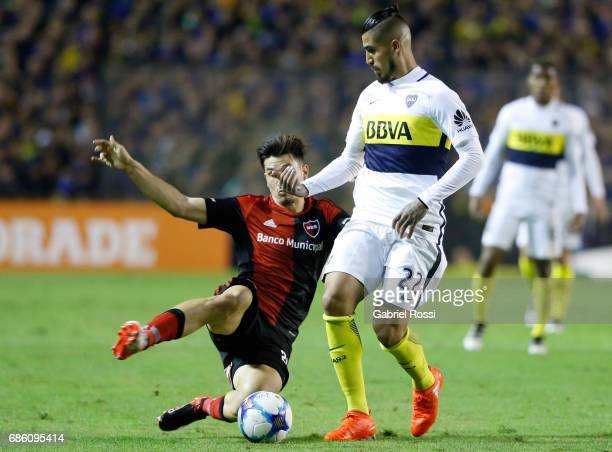 Oscar Benitez of Boca Juniors fights for the ball with Eugenio Isnaldo of Newell's Old Boys during a match between Boca Juniors and Newell's Old Boys...