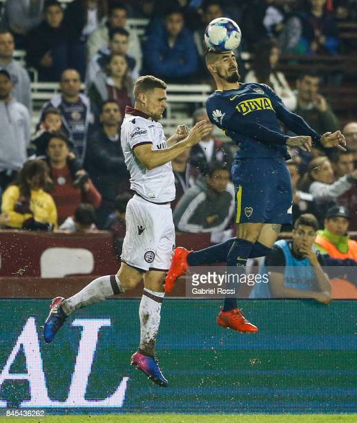 Oscar Benitez of Boca Juniors heads the ball during a match between Lanus and Boca Juniors as part of the Superliga 2017/18 at Ciudad de Lanus...