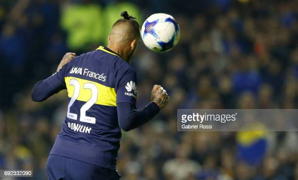 Oscar Benitez of Boca Juniors heads the ball to score the second goal of his team during a match between Boca Juniors and Independiente as part of...