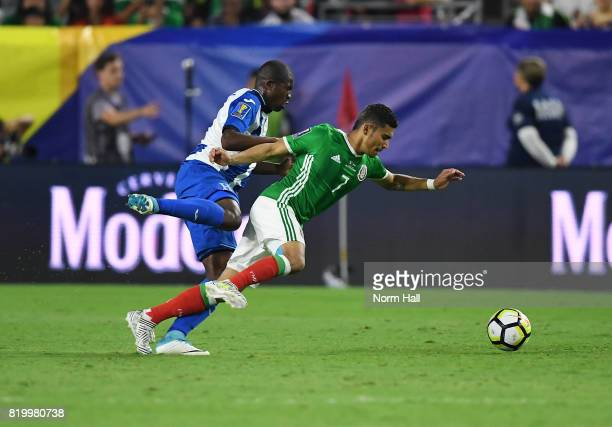 Oscar Boniek Garcia of Honduras challenges Orbelin Pineda of Mexico for the ball during the second half in a quarterfinal match during the CONCACAF...