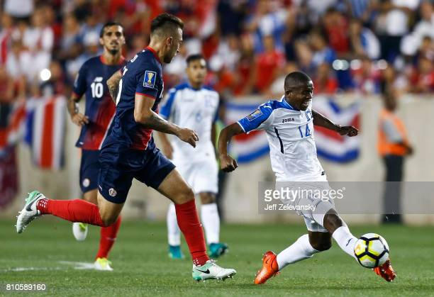 Oscar Boniek Garcia of Honduras drives by Francisco Calvo of Costa Rica during their CONCACAF Gold Cup match at Red Bull Arena on July 7 2017 in...