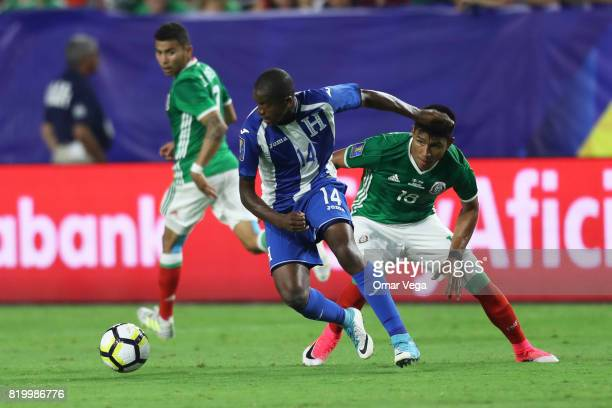 Oscar Boniek of Honduras and Jesus Gallardo of Mexico compete for the ball during the CONCACAF Gold Cup 2017 quarterfinal match between Mexico and...