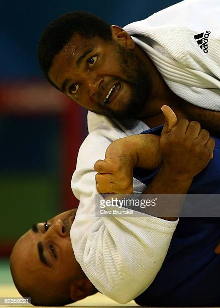 Oscar Brayson of Cuba looks up as he pins Rudy Hachache of Lebanon in the men's 78 kg preliminaryO judo event at the University of Science and...