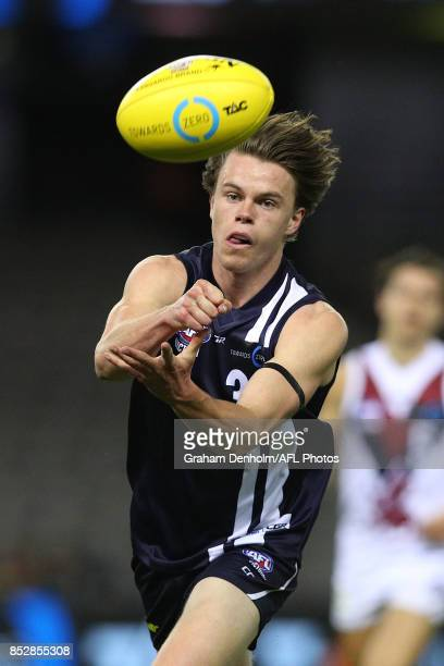Oscar Brownless of the Geelong Falcons handballs during the TAC Cup Grand Final match between Geelong and Sandringham at Etihad Stadium on September...