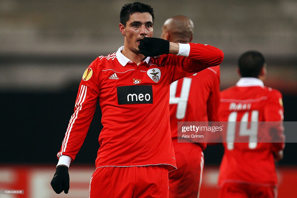 Oscar Cardozo of Benfica celebrates his team's second goal during the UEFA Europa League match round of 32 second leg between VfB Stuttgart and Benfica at Mercedes-Benz Arena on February 24, 2011 in Stuttgart, Germany.