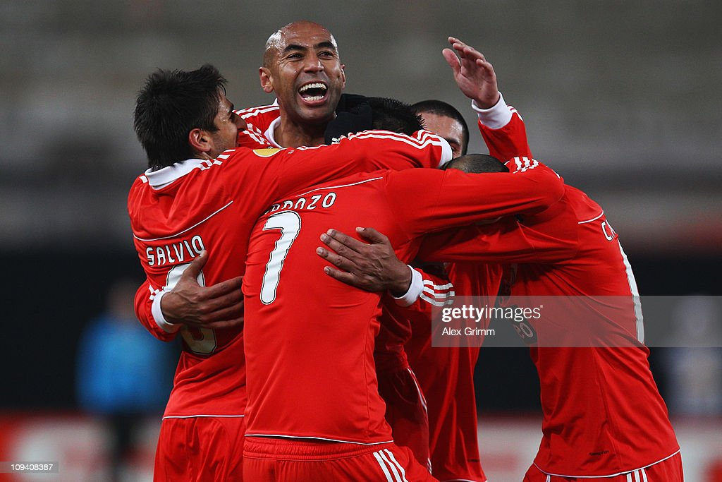 Oscar Cardozo (front) of Benfica celebrates his team's second goal with team mates during the UEFA Europa League match round of 32 second leg between VfB Stuttgart and Benfica at Mercedes-Benz Arena on February 24, 2011 in Stuttgart, Germany.