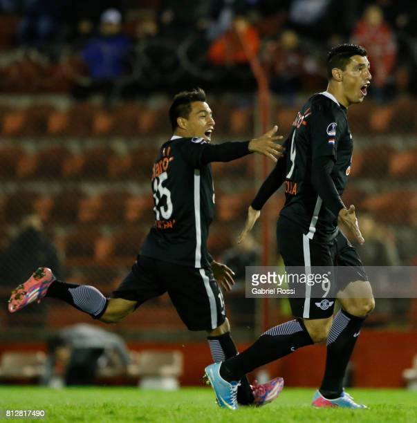 Oscar Cardozo of Libertad celebrates with teammate Angel Cardozo Lucena after scoring the opening goal of his team during a first leg match between...