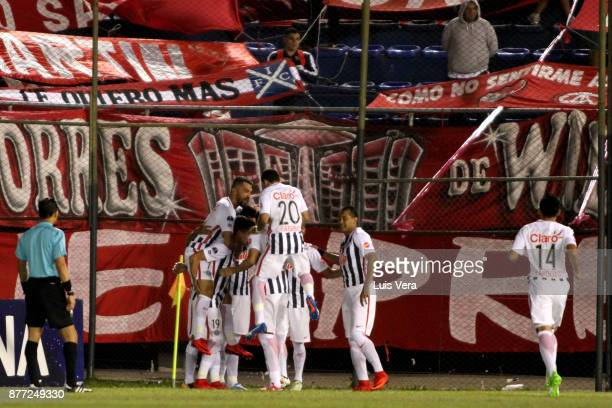Oscar Cardozo of Libertad celebrates with teammates after scoring the first goal of his team during a first leg match between Libertad and...