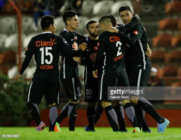 Oscar Cardozo of Libertad celebrates with teammates Jesus Medina Angel Cardozo Lucena Antonio Bareiro and Alan Benitez after scoring the opening goal...