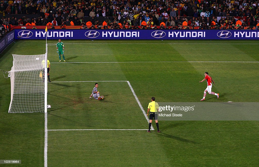 <a gi-track='captionPersonalityLinkClicked' href=/galleries/search?phrase=Oscar+Cardozo&family=editorial&specificpeople=2080093 ng-click='$event.stopPropagation()'>Oscar Cardozo</a> of Paraguay celebrates after scoring his penalty to win his team a penalty shoot-out during the 2010 FIFA World Cup South Africa Round of Sixteen match between Paraguay and Japan at Loftus Versfeld Stadium on June 29, 2010 in Pretoria, South Africa.