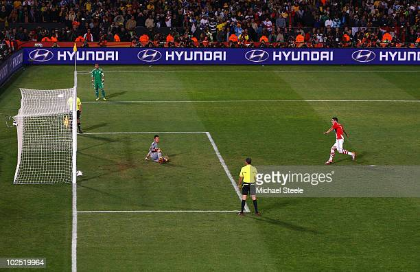 Oscar Cardozo of Paraguay celebrates after scoring his penalty to win his team a penalty shootout during the 2010 FIFA World Cup South Africa Round...