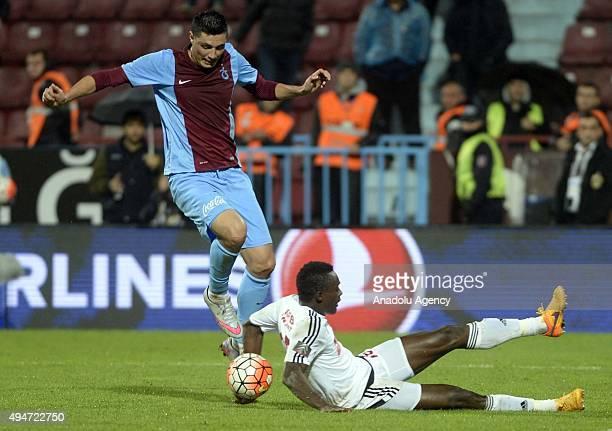 Oscar Cardozo of Trabzonspor vies with Arokoyo during a Turkish Spor Toto Super League soccer match between Trabzonspor and Gaziantepspor at Huseyin...